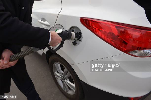 A photo taken on December 3 2015 shows an ix35 Fuel Cell vehicle by Korean car manufacturer Hyundai at a short time Air Liquide hydrogen temporary...