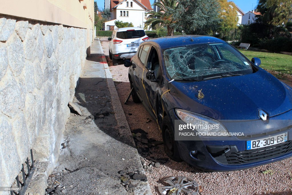 A photo taken on December 7, 2013 shows the place where the Ajaccio's gendarmerie was hit by rockets two days before, in the French Mediterranean island of Corsica. AFP PHOTO / PASCAL POCHARD-CASABIANCA