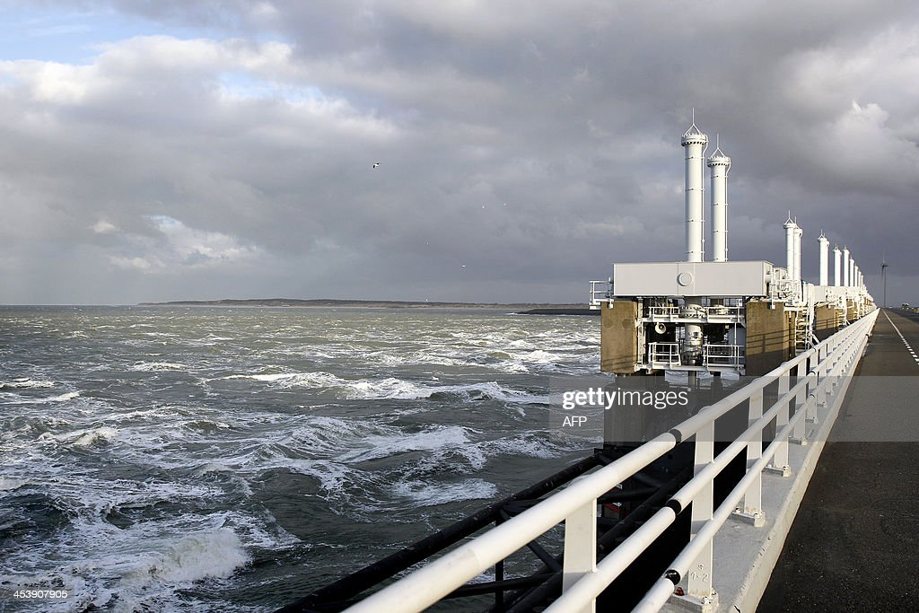A photo taken on Decmber 6 2013 shows high water at the Eastern Scheldt storm surge barrier in Oosterschelde The Netherlands The gates were closed...