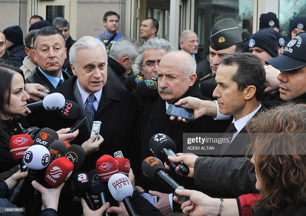 A photo taken on February 1, 2013 shows US ambassador to Turkey Francis J. Ricciardone (C, L) and provincial governor Alaaddin Yuksel (C, R) giving a press point at the site of a blast outside the US Embassy in Ankara. The Turkish government denounced on February 7, 2013 comments made by the US Ambassador who criticized the prolonged pre-trial detention of officers and people accused of conspiracy.