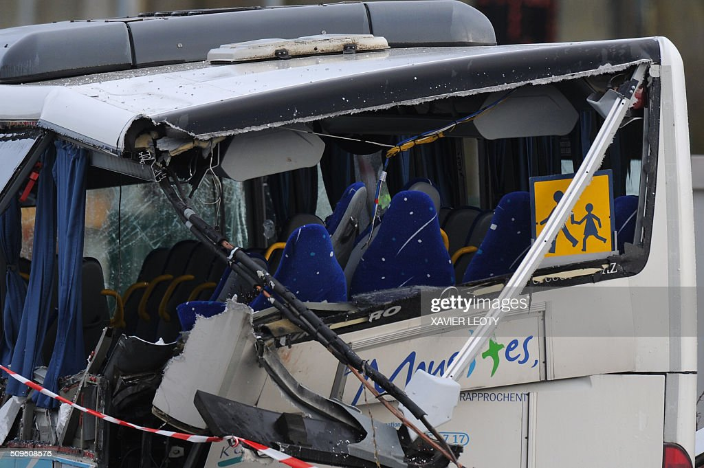 A photo taken on February 11, 2016 shows a detail of the wreckage of a school minibus after it crashed into a truck in Rochefort, killing at least six children, police said, a day after another road accident involving a school bus left two youngsters dead. The head-on smash with a lorry carrying rubble came around 7:15 am (0615 GMT) in Rochefort in the western Charente-Maritime region. / AFP / XAVIER LEOTY