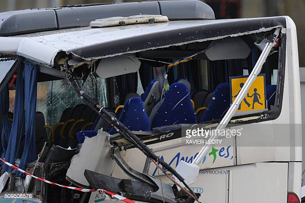 A photo taken on February 11 2016 shows a detail of the wreckage of a school minibus after it crashed into a truck in Rochefort killing at least six...