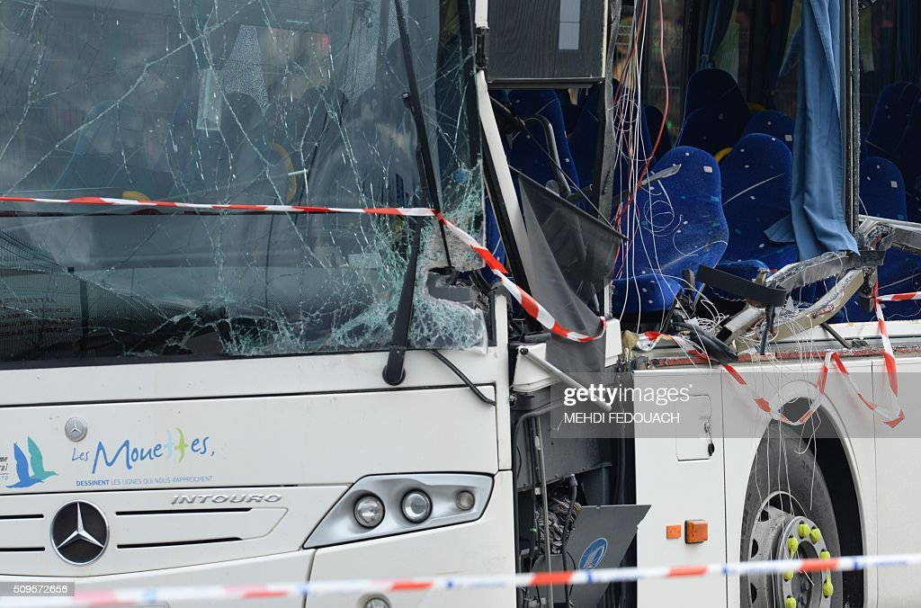 A photo taken on February 11, 2016 shows a detail of the wreckage of a school minibus after it crashed into a truck in Rochefort, killing at least six children, police said, a day after another road accident involving a school bus left two youngsters dead. The head-on smash with a lorry carrying rubble came around 7:15 am (0615 GMT) in Rochefort in the western Charente-Maritime region. The school bus was carrying about 17 people, and three children suffered minor injuries in the accident, a police source said. / AFP / MEHDI FEDOUACH