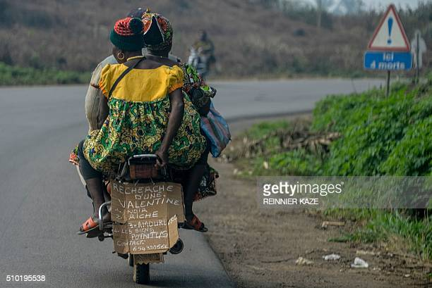 A photo taken on February 11 2016 shows a mototaxi chauffeur advertising the qualities he seeks from a prospective 'valentine' with a sign on the...
