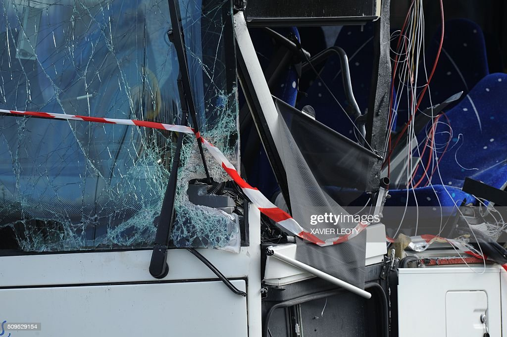A photo taken on February 11, 2016 shows the wreckage of a school bus after it crashed into a truck in Rochefort, killing at least six children, police said, a day after another road accident involving a school bus left two youngsters dead. The head-on smash with a lorry carrying rubble came around 7:15 am (0615 GMT) in Rochefort in the western Charente-Maritime region. LEOTY