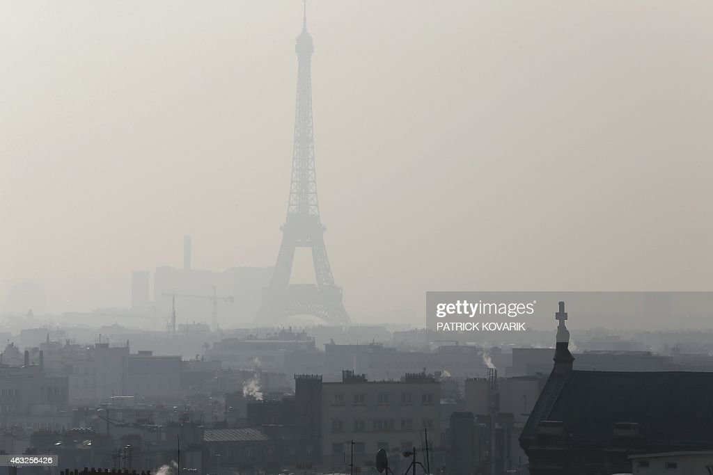 A photo taken on February 12 2015 in Paris shows the Eiffel Tower through thick smog AFP PHOTO / PATRICK KOVARIK