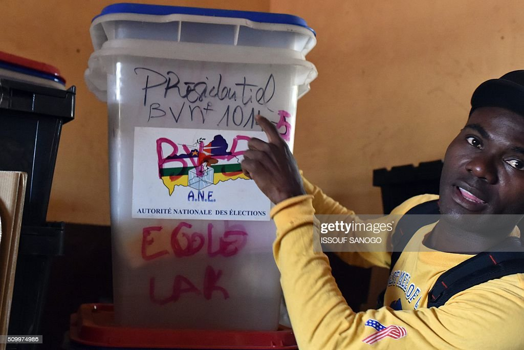 A photo taken on Febuary 13, 2016 in Bangui, shows an electoral workers checking ballot boxes and other voting material that will be used in the Central African Republic second round presidential and legslatives elections. The Central African Republic holds delayed presidential and parliamentary polls on February 14, with voters desperate to usher in peace after the country's worst sectarian violence since independence in 1960. / AFP / ISSOUF SANOGO