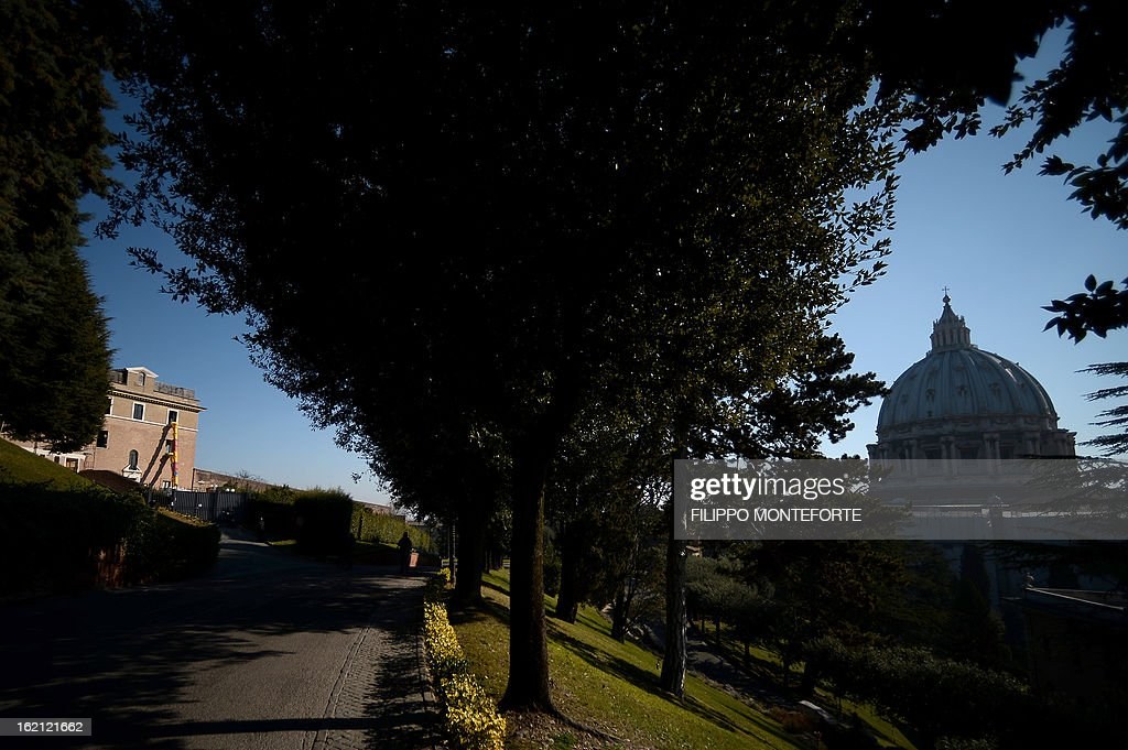 A photo taken on February 19, 2013 shows the convent of Mater Ecclesiae (Mother of the Church) by St.Peter's Dome in the Vatican City State. The building will host Pope Benedict XVI, offering him a substantial four-story modern home complete with contemporary chapel, garden and a roof terrace looking out from a rise dominated by the Holy See's TV transmission tower. Pope Benedict XVI began a week-long spiritual retreat out of the public eye on Monday ahead of his resignation on February 28 with the field of candidates to succeed him still wide open. AFP PHOTO/ Filippo MONTEFORTE