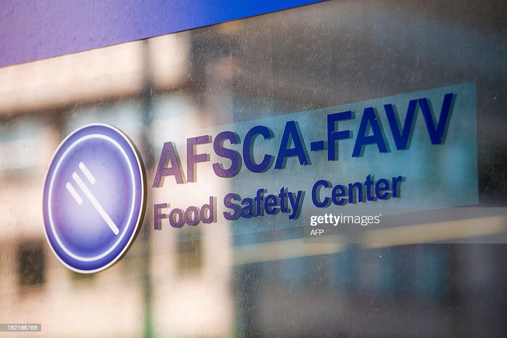 A photo taken on February 20, 2013 shows the logo of the Federal Agency for the safety of the food chain (FASFC) at the entrance to the headquarters in Brussels.