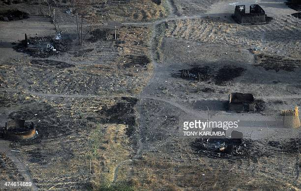 A photo taken on February 21 2014 shows a compound with burnt tukuls at a village in Panyijiar county Unity state South Sudan Thousands of Nuer...