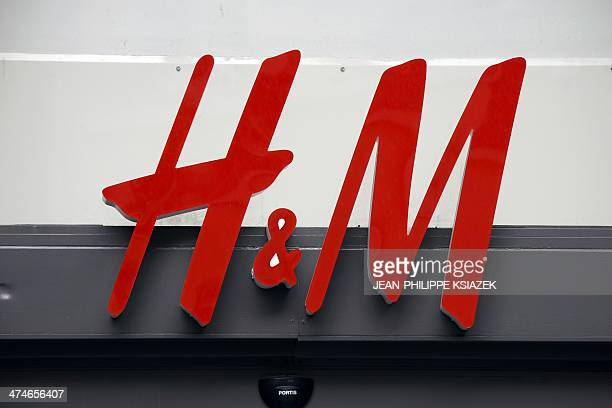 Photo taken on February 21 2014 shows the sign of an HM clothing store in Lyon centraleastern France AFP PHOTO / JEANPHILIPPE KSIAZEK