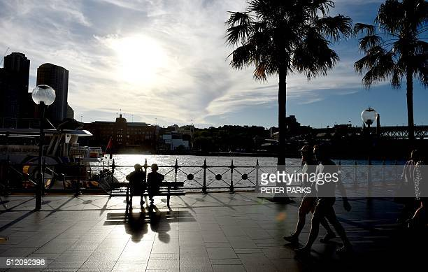 Photo taken on February 23 2016 shows people visiting Circular Quay and Sydney Harbour in the city of Sydney Weather forecasters are predicting a...