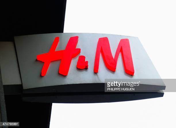 Photo taken on February 24 2014 shows the sign of an HM clothing store in the French northern city of Lille AFP PHOTO / PHILIPPE HUGUEN