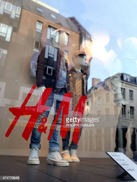 Photo taken on February 24 2014 shows the vitrine of a HM clothing store in the French northern city of Lille AFP PHOTO / PHILIPPE HUGUEN
