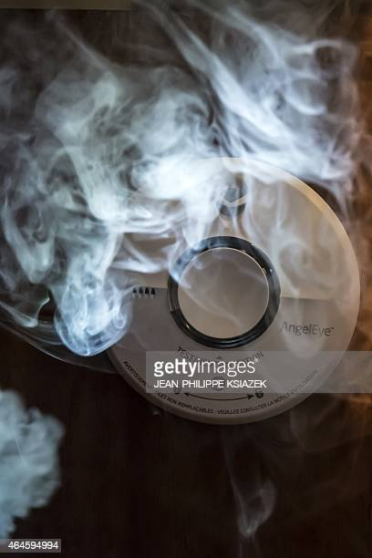 A photo taken on February 26 2015 shows a smoke detector in a home in Lyon The Federation Francaise des Metiers de l'Incendie estimates in a...