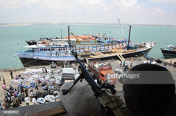 Photo taken on February 27 2013 shows a Kenyan soldier standing guard in a building near the Kismayo seaport Recent clashes broke out between rival...