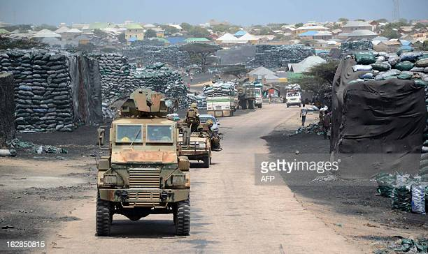 Photo taken on February 27 2013 shows Kenyan convoys patrolling near Kismayo seaport Recent clashes broke out between rival progovernment clanbased...