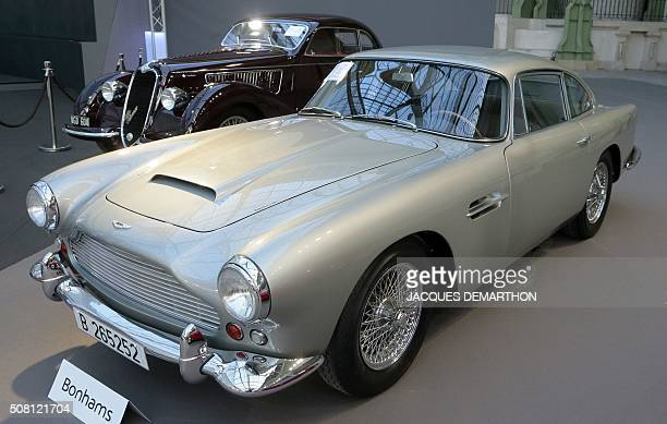 A photo taken on February 3 2016 shows a 961 Aston Martin DB série IV coupe on display during a sale of vintage cars and motorcycles at the Grand...