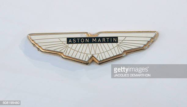 A photo taken on February 3 2016 shows the bonnet badge of a 1970's Aston Martin car on display during a sale of vintage cars and motorcycles at the...