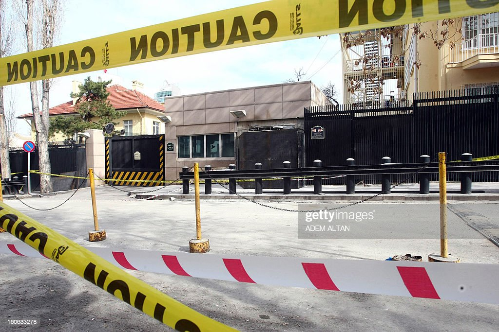 A photo taken on February 4, 2013 shows the side entrance of the US Embassy in Ankara surrounded by tape and metal sheeting after a suicide bomber blew himself up on February 1 outside the facility. A radical Turkish Marxist group, the Revolutionary People's Liberation Front (DHKP-C), claimed responsibility for the bomb attack at the embassy, where a Turkish security guard was killed.