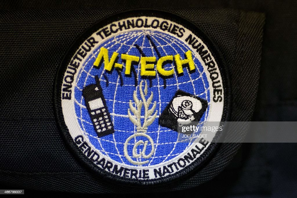 A photo taken on February 4, 2014 in Nanterre, near Paris, shows the logo of the French gendarmerie's 'N-TECH' squad specialized in new technologies, on a police officer's vest at the PHAROS internet investigation unit. PHAROS is part of the French Anti-Cybercrime Office (OCLCTIC).