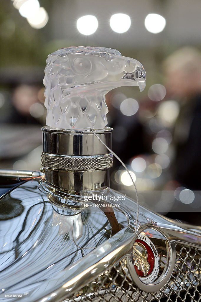 Photo taken on February 6, 2013 shows a detail of the radiator cap of the 1929 Minerva Type AK Faux Cabriolet on display at the Grand Palais in Paris on the eve of an auction of luxury vintage cars. 125 vintage motor cars, 100 collection motorbikes and a 1920's Gipsy Moth plane by De Havilland, will be auctionned at Bonhams on February 7. AFP PHOTO BERTRAND GUAY