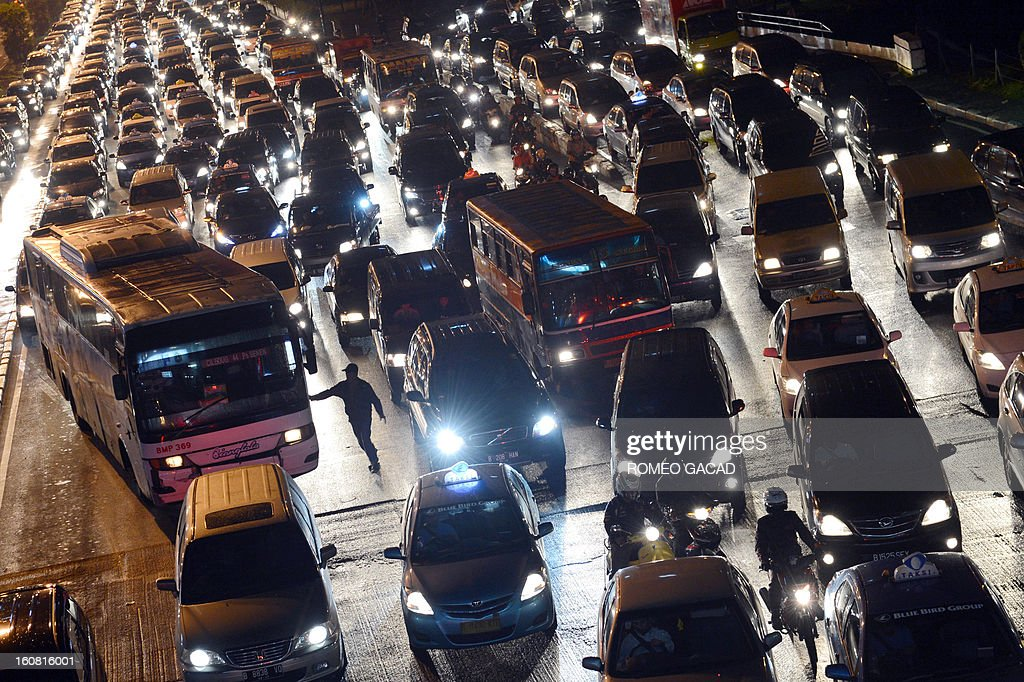 Photo taken on February 6, 2013 shows a massive traffic jam along Jakarta's main Sudirman road following a heavy downpour causing temporary floods on the capital's roads. Indonesia's capital notorious for its traffic jam and city of some 9 million people is lacking effective mass transport system.