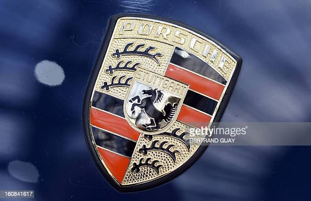 Photo taken on February 6 2013 shows the Porsche logo on a car displayed at the Grand Palais in Paris on the eve of an auction of luxury vintage cars...