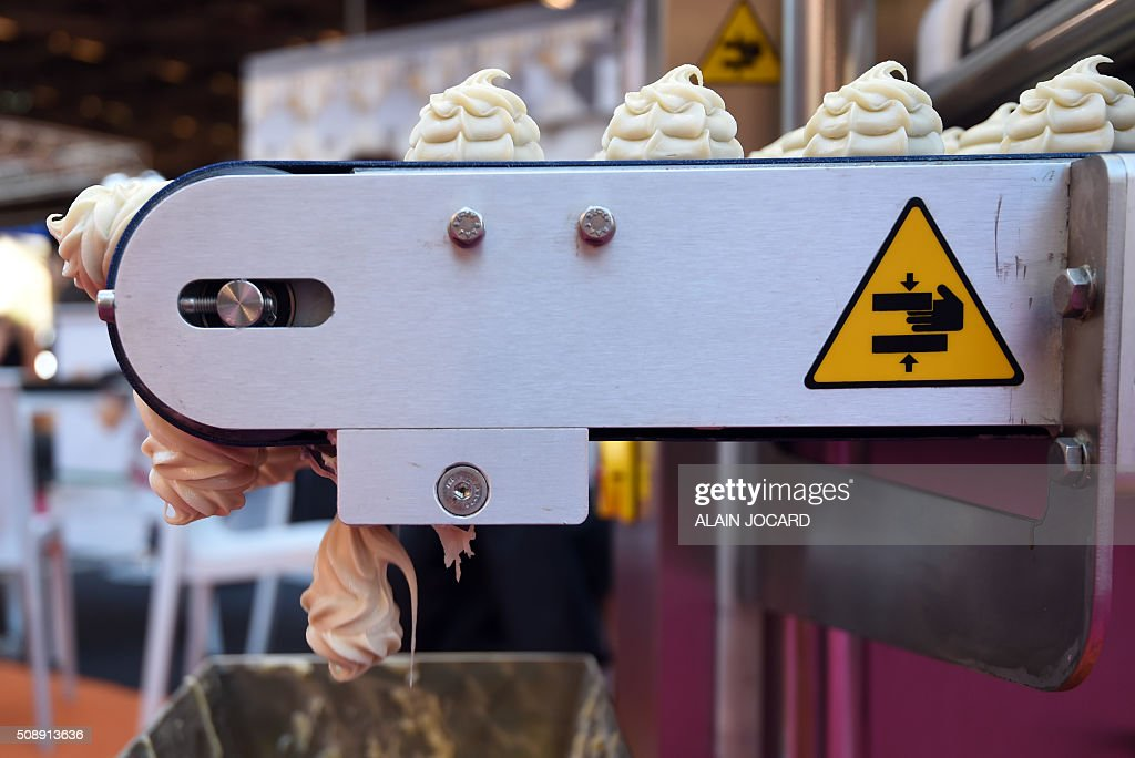 A photo taken on February 7, 2016 shows a pastry production machine on display at the stand of the Italian manufacturer Mimac at the 'Europain' fair in Villepinte near Paris. / AFP / ALAIN JOCARD