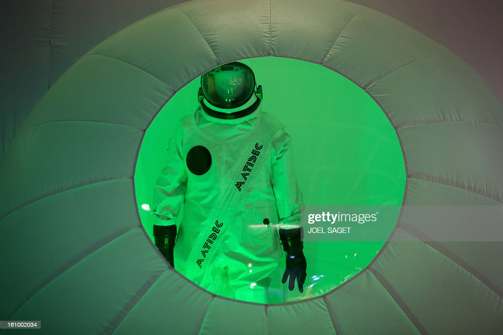 A photo taken on February 8, 2013 shows an Ergolier protection suit made by Matisec company used by technicians working on the construction of the Ariane rocket on display at the exhibition 'Futurotextiles 3' scheduled until July 14 at the Cite des Sciences et de l'Iindustrie in Paris.
