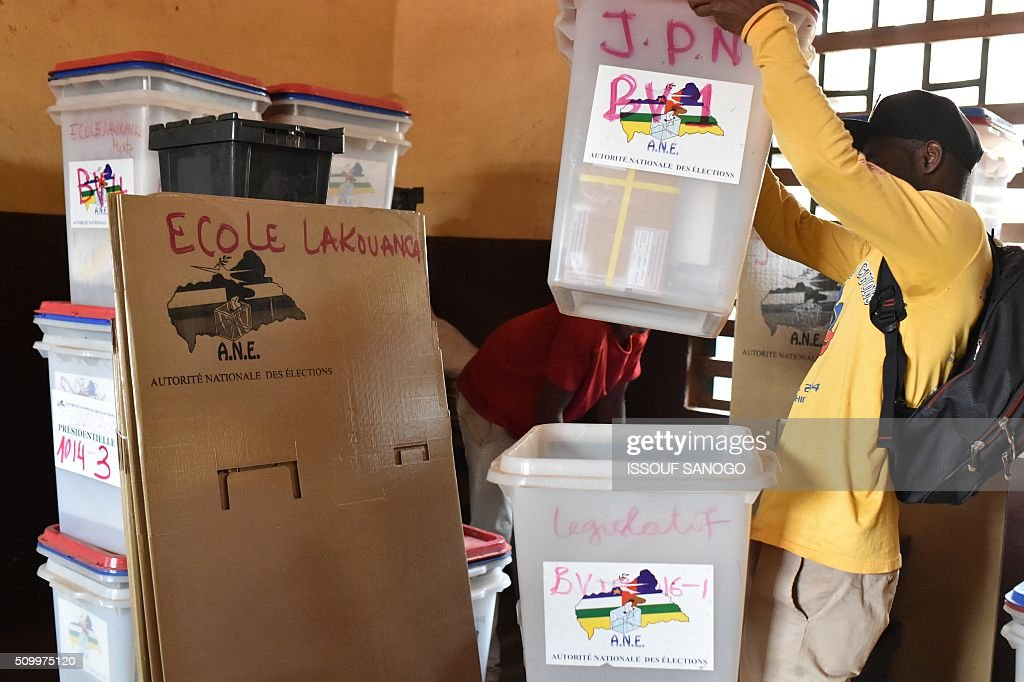 A photo taken on Febuary 13, 2016 in Bangui, shows an electoral workers checking voting material that will be used in the Central African Republic second round presidential and legslatives elections. The Central African Republic holds delayed presidential and parliamentary polls on February 14, with voters desperate to usher in peace after the country's worst sectarian violence since independence in 1960. / AFP / ISSOUF SANOGO