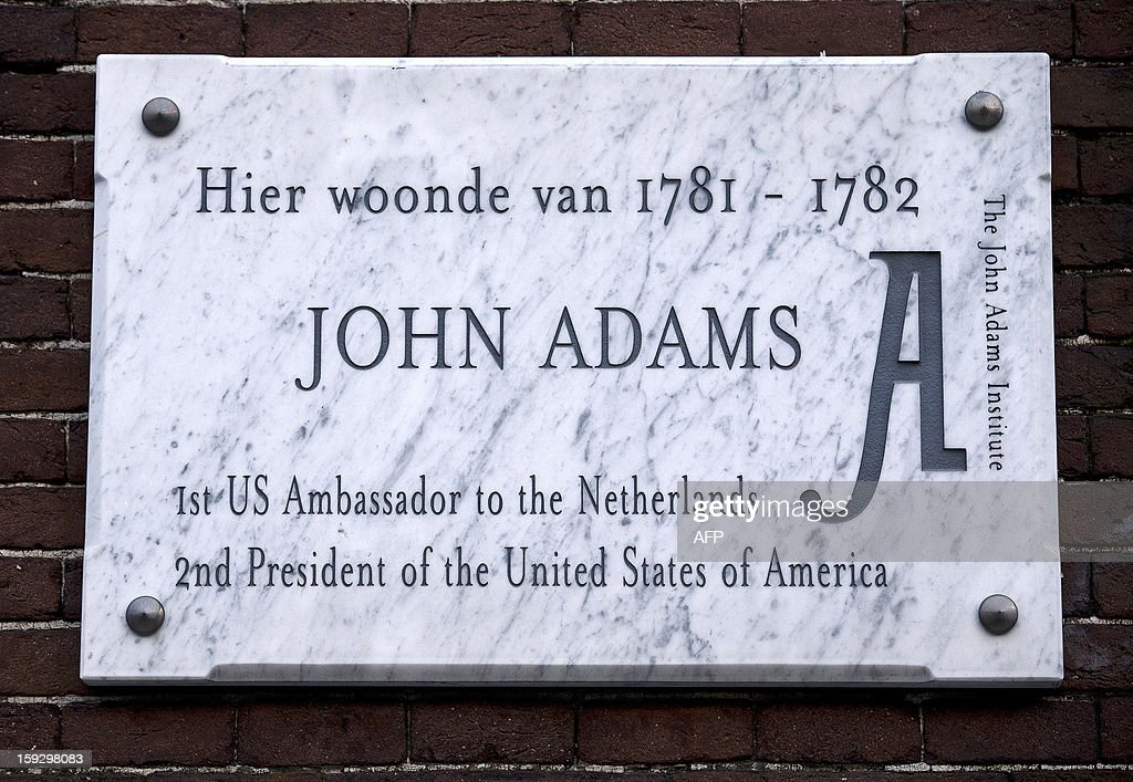 Photo taken on January 10, 2013 shows a plaque mentionning that John Adams, the 2nd US President, lived at Keizersgracht 529 in Amsterdam from 1781 until 1782. 2013 will mark the 400th anniversary since construction began on Amsterdam's world renowned Canal Ring that was added to the UNESCO World Heritage list. AFP PHOTO / ANP / JERRY LAMPEN -- The Netherlands out --