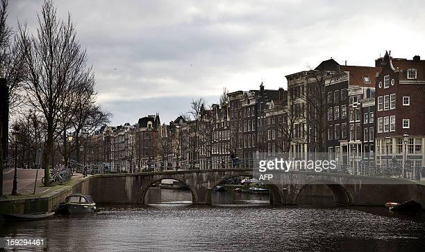 Photo taken on January 10 2013 shows the Keizersgracht one of the city of Amsterdam's three main canals 2013 will mark the 400th anniversary since...