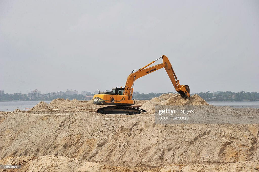 Photo taken on January 11, 2013 shows a digging excavator on the construction site of the 'Henri Konan Bedie' toll bridge on the Ebrie Lagoon in Abidjan, built by French group Bouygues.