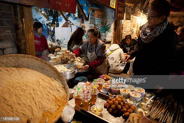 A photo taken on January 14 2011 shows a food stall in Chengdu Sichuan province The capital of Sichuan Chengdu and its surrounding area is widely...