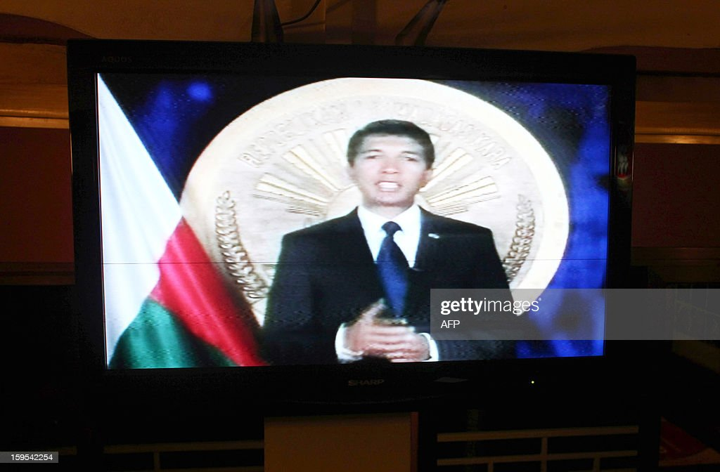 A photo taken on January 15, 2013 in Antananarivo, shows a TV screen displaying Andry Rajoelina, president of the Transition in Madagascar, giving a speech on the Malagasy National TV channel. Madagascar strongman Andry Rajoelina said today that he will not run in crunch presidential elections in May 2013, a decision that could help end a political crisis that erupted when he seized power in 2009. 'I will not be a candidate at the elections, I will sacrifice myself for the sake of the 20 million Malagasy,' he said in a prime-time television address to the nation. Rajoelina had been under fierce international pressure not to run in the polls, as a way to end an almost four-year crisis that has led to a range of sanctions that have crippled the economy.