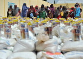 A photo taken on January 19 2012 shows displaced Somali women queuing for foodaid rations at a distribution centre during a visit to assess the...