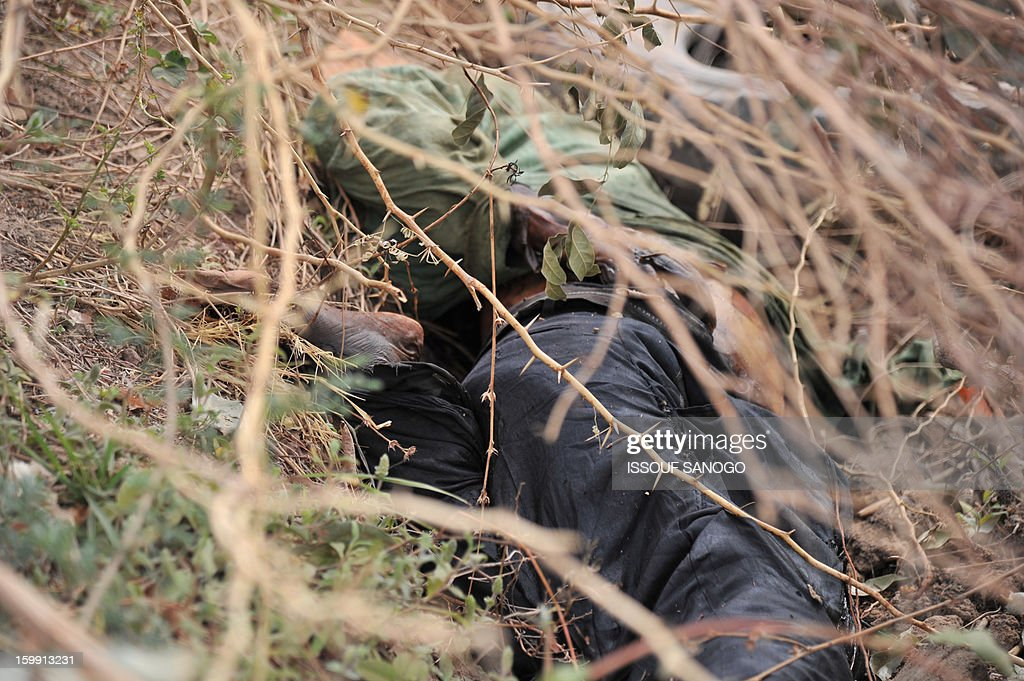 A photo taken on January 22, 2013 show the body of an alleged Islamist in Diabaly. Mali told the UN on January 22, 2013 that advances it had made in the field of human rights were being undermined by the conflict raging across the country. The French ambassador to the UN in Geneva Nicolas Niemtchinow voiced concern about the recruitment of child soldiers, sexual violence against women and the treatment of prisoners in the country, and urged Bamako to prevent 'acts of retaliation' and to 'disarm the militias.AFP PHOTO / ISSOUF SANOGO