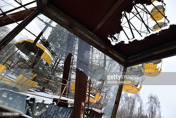 A photo taken on January 22 2016 shows snow covered ride at the amusement park in the ghost city Pripyat near to Chernobyl Power Plant On April 26...
