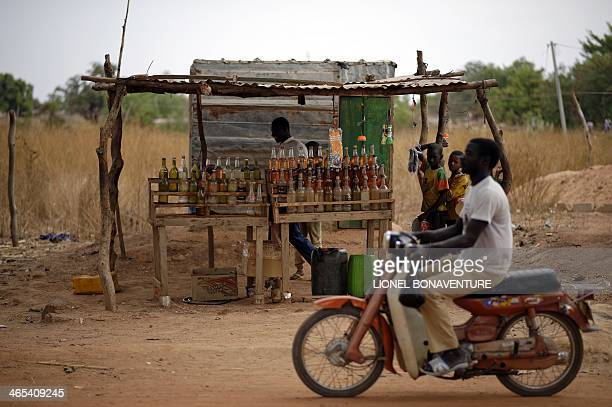 A photo taken on January 24 2014 shows a petrol seller in Leo Burkina Faso The French cosmetics company L'Occitane has been working with women...