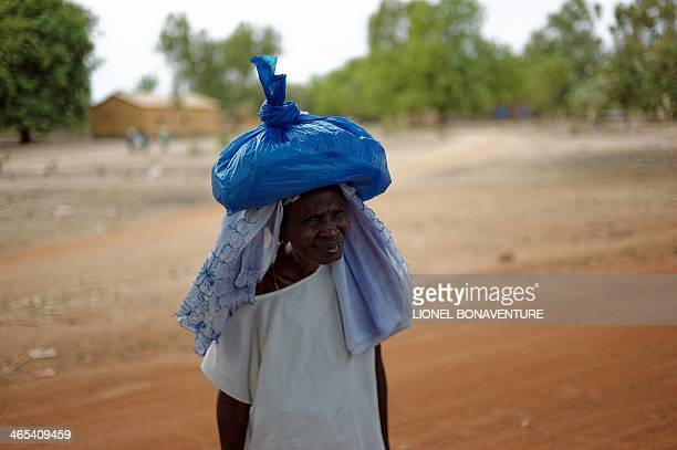 A photo taken on January 24 2014 shows a woman in Leo Burkina Faso The French cosmetics company L'Occitane has been working with women producing shea...