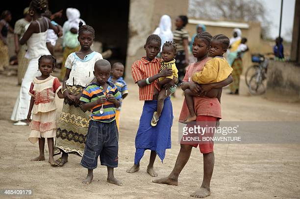 A photo taken on January 24 2014 shows children in Leo Burkina Faso The French cosmetics company L'Occitane has been working with women producing...