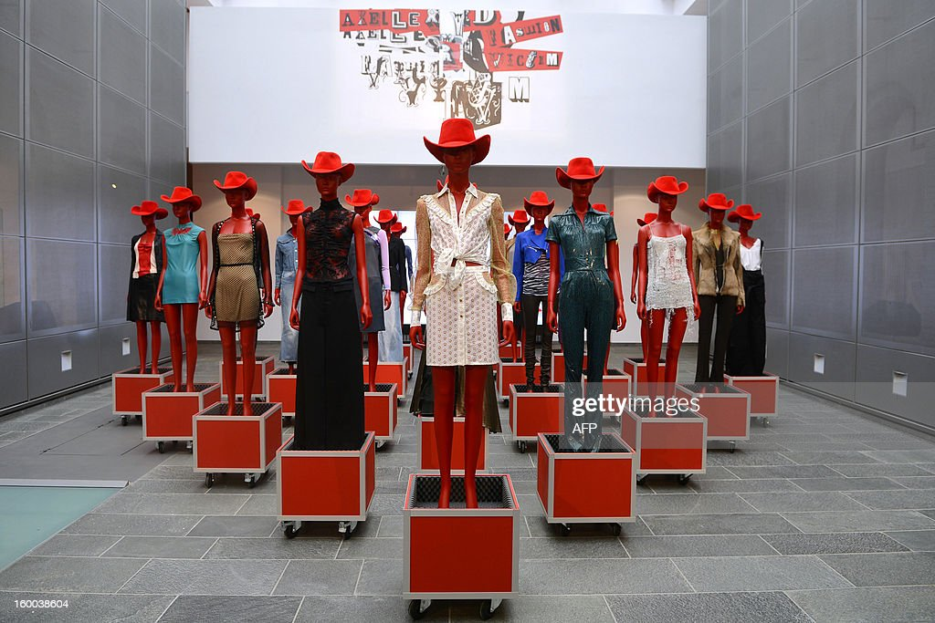 Photo taken on January 25, 2013 shows line of clothes on display during the presentation of a book and exhibition called 'Axelle Red – Fashion Victim' at the fashion museum in Hasselt, Belgium.