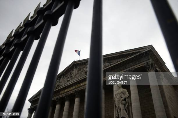 A photo taken on January 27 2016 shows the French flag flying over the French National Assembly in Paris / AFP / JOEL SAGET