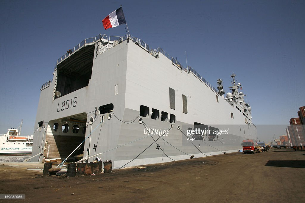 A photo taken on January 28, 2013 in Dakar harbour shows the French military ship and helicopter carrier 'Le Dixmude', part of the French military operation Serval in Mali. French paratroopers swooped in to try to block fleeing hardliners as ground troops coming from the south seized the airport in the ancient city which has been one of the bastions of the extremists controlling the north for 10 months. AFP PHOTO / Mamadou Toure BEHAN