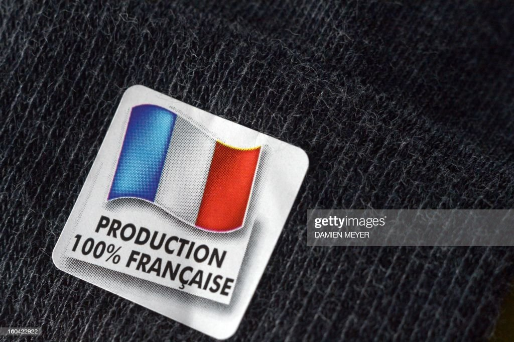 A photo taken on January 30, 2013 in Rennes, western France, shows a '100% made in France' tag on a pair of socks. AFP PHOTO DAMIEN MEYER