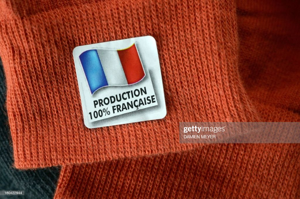 A photo taken on January 30, 2013 in Rennes, western France, shows a '100% made in France' tag on a pair of socks.