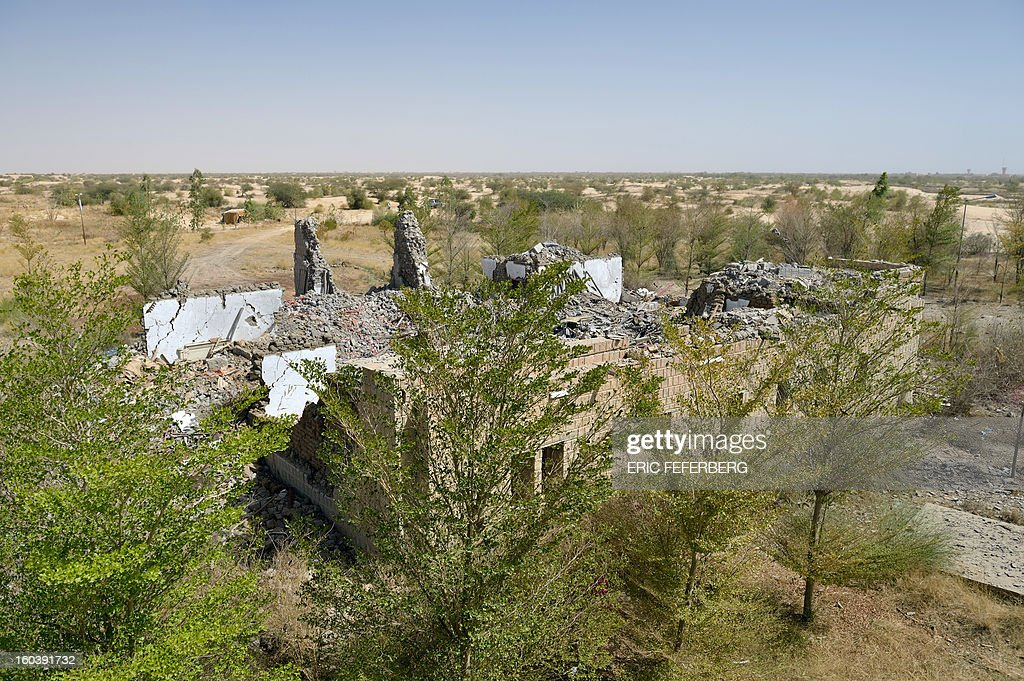 A photo taken on January 30, 2013 shows the bombed out villa of late Libyan dictator Moamer Kadhafi near the airport of the northern Malian city of Timbuktu. The house was used by the Al Qaeda-linked Islamists who had seized the city 10 months ago. It was bombarded by French military planes on January 28 when French-led forces recaptured the city.