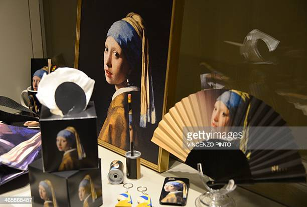 A photo taken on January 30 2014 shows merchandise featuring the masterpiece 'Girl with a Pearl Earring' by Dutch painter Johannes Vermeer during a...