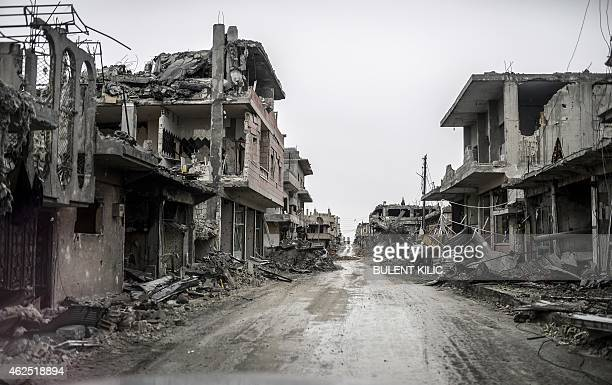A photo taken on January 30 2015 shows a street view of the eastern part of the destroyed Syrian town of Kobane also known as Ain alArab Kurdish...